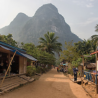 The photo shows the main street of Muang Ngoi Neua.