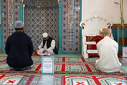 © Licensed to London News Pictures. 06/07/2020. London, UK. Members of staff praying 2 meters apart in the Mosque. Wightman Road Mosque, also known as London Islamic Cultural Society and Mosque, in north London, prepares to open after the COVID-19 lockdown, by placing a number of measures required by law for worshippers. The government announced that gatherings of more than 30 worshippers are allowed for acts of communal worship in churches, synagogues, mosques, temples and other places of worship. All worshippers attending Mosques will have to wear face coverings and bring their own prayer mat, Quran, and a reusable shoe bag. Photo credit: Dinendra Haria/LNP