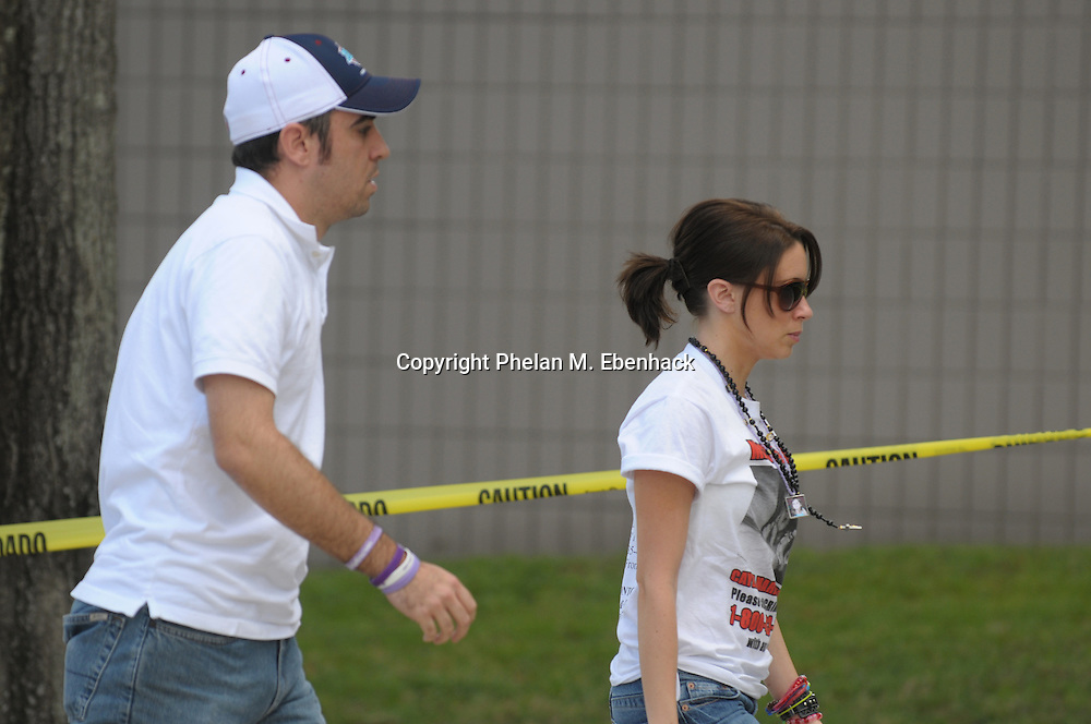 Casey Anthony, mother of missing three-year-old Caylee Anthony, is escorted by her brother Lee Anthony for a meeting with her home confinement officer for economic charges at the Orange County Jail Monday, Sept. 15, 2008.  Anthony is on home confinement for charges relating to the disappearance of her daughter.