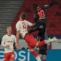 Sadio Mane (L) of Liverpool FC and Emil Forsberg (R) of RB Leipzig go for a header during the UEFA Euro League match between RB Leipzig and Liverpool FC in Budapest, Hungary on Feb. 16, 2021. ATTILA VOLGYI