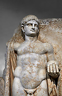 Detail of a Roman Sebasteion relief  sculpture of Emperor Nero with captive, Aphrodisias Museum, Aphrodisias, Turkey.  Against a grey background.<br /> <br /> Naked warrior emperor Nero holds the orb of world rule in one hand and crowns the military trophy with the other. Between the trophy and the emperor stands a bound captive boy. He wears long barbarian trousers and looks up at Nero. .<br /> <br /> If you prefer to buy from our ALAMY STOCK LIBRARY page at https://www.alamy.com/portfolio/paul-williams-funkystock/greco-roman-sculptures.html . Type -    Aphrodisias     - into LOWER SEARCH WITHIN GALLERY box - Refine search by adding a subject, place, background colour, museum etc.<br /> <br /> Visit our ROMAN WORLD PHOTO COLLECTIONS for more photos to download or buy as wall art prints https://funkystock.photoshelter.com/gallery-collection/The-Romans-Art-Artefacts-Antiquities-Historic-Sites-Pictures-Images/C0000r2uLJJo9_s0