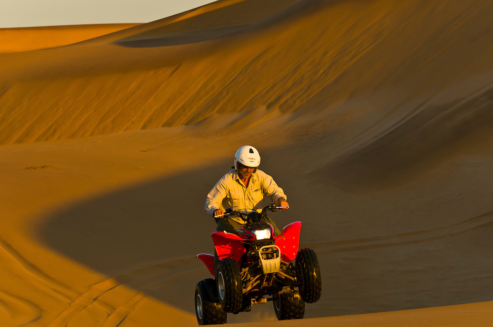 Riding Quad Bikes (All Terrain Cycle) in the Swakopmund Dunes, Swakopmund, Namib Desert, Namibia