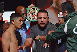 September 15, 2017 - Las Vegas, Nevada, United States of America - NABF Super Bantamweight champion Randy Caballero head butts boxer Diego De La Hoya during the weigh in ceremony for their super bantamweight bout on September14, 2017 at the MGM Grand  Garden Arena in Las Vegas, Nevada (Credit Image: © Marcel Thomas via ZUMA Wire)