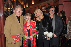 Left to right, STEPHEN WAY, GLORIA HUNNIFORD and PAUL & LISA KEATING at the opening night of Cinderella at The New Wimbledon Theatre, 93 The Broadway, London SW19 1QG on 9th December 2014.