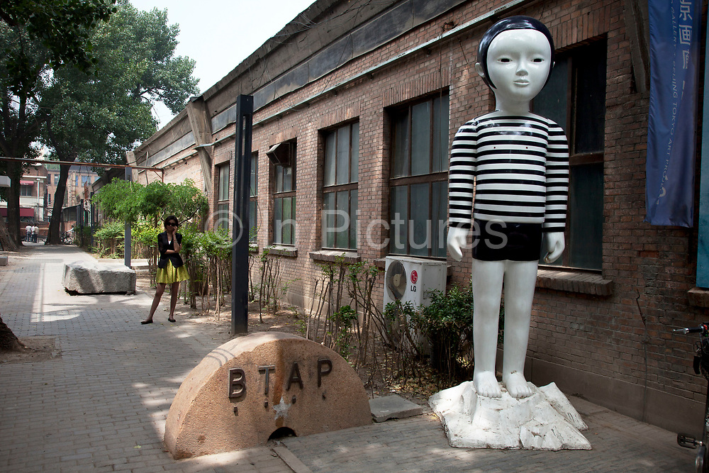 Contemporary art sculpture installed outside on one of the lanes inside 798. 798 Art Zone or Dashanzi Art District, is a part of Dashanzi in the Chaoyang District of Beijing, China that houses a thriving artistic community, among 50-year old decommissioned military factory buildings of unique architectural style. The area is often called the 798 Art District or Factory 798 although technically, Factory #798 is only one of several structures within a complex formerly known as Joint Factory 718.