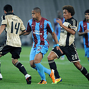 Trabzonspor's Paulo Henrique Carneiro FILHO (C) and Benfica's Axel WITSEL (2ndR) during their UEFA Champions League third qualifying round, second leg, soccer match Trabzonspor between Benfica at the Ataturk Olimpiyat Stadium at İstanbul Turkey on Wednesday, 03 August 2011. Photo by TURKPIX
