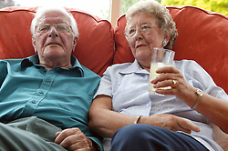 Couple relaxing on a sofa,