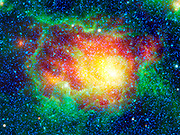 This colorful picture is a mosaic of the Lagoon nebula taken by NASA's WISE. Also known as Messier 8, or simply M8, the Lagoon nebula is seen here as a large circular cloud in the center of the image, surrounded by innumerable stars.