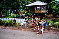 Indonesia, Sulawesi, Remboken. Remboken is a small village near Lake Tondano in the Minahasa highlands. The speciality craft here is pottery. Children playing in the street.