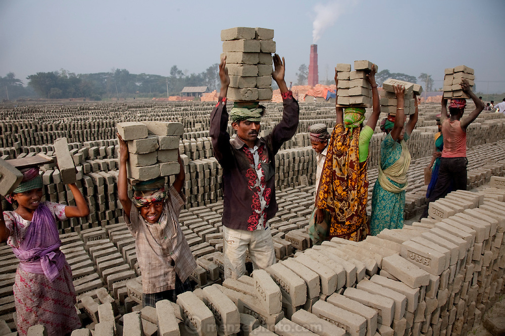 Factory workers carry bricks at the JRB brick factory near Sonargaon, outside Dhaka, Bangladesh. (From the book What I Eat: Around the World in 80- Diets.)