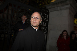 © licensed to London News Pictures. London, UK 14/10/2012. Dr David Ison, Dean of St Paul's giving a statement to the media outside St Paul's as four Occupy London protesters chained themselves inside the church. Photo credit: Tolga Akmen/LNP