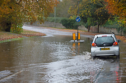 © Licensed to London News Pictures. 15/11/2020.  <br /> East Malling, UK. A motorist having to drive on the wrong side of the road to avoid deep floodwater in East Malling in Kent. Over one hundred flood alerts are put in place by the Met Office today as the UK is hit with heavy overnight rain and gale force winds. Photo credit:Grant Falvey/LNP