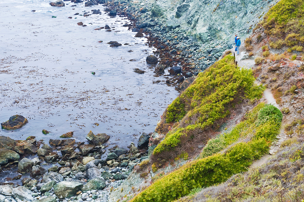 Hikers on the Jade Cove trail overlooking Jade Cove, Los Padres National Forest, Big Sur, California