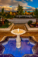A moorish fountain with the Alhambra palace in background,  Granada, Granada Province, Spain.