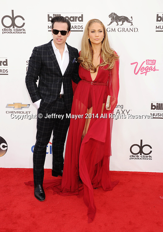 LAS VEGAS, CA- MAY 18: Actress/singer Jennifer Lopez (R) and Casper Smart arrive at the 2014 Billboard Music Awards at the MGM Grand Garden Arena on May 18, 2014 in Las Vegas, Nevada.