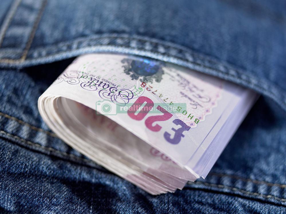Dec. 14, 2012 - Twenty pound notes in a pocket (Credit Image: © Image Source/ZUMAPRESS.com)
