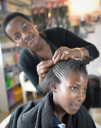 Nov. 26, 2014 - Cape Town, South Africa - Netsai Magasa, a local hairdresser, in Imizamo Yethu town ship. Cape Town, South Africa. Photo credit: Artur Widak  (Credit Image: © Artur Widak/NurPhoto/ZUMA Wire)