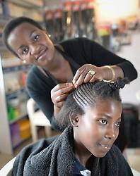 Nov. 26, 2014 - Cape Town, South Africa - Netsai Magasa, a local hairdresser, in Imizamo Yethu town ship. Cape Town, South Africa. Photo credit: Artur Widak  (Credit Image: © Artur Widak/NurPhoto/ZUMA Wire)