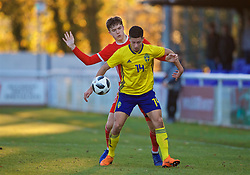 BANGOR, WALES - Saturday, November 17, 2018: Wales' Morgan Boyes (L) and Sweden's Kevin Yakob during the UEFA Under-19 Championship 2019 Qualifying Group 4 match between Sweden and Wales at the Nantporth Stadium. (Pic by Paul Greenwood/Propaganda)