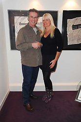 Photographer GERED MANKOWITZ and LINDSEY CARLOS CLARKE at a private view of photographs held at the Little Black Gallery, Park Walk, London on 20th January 2010.