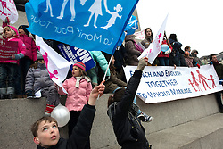 © Licensed to London News Pictures. 24/03/2013. London, UK. Supporters hold signs up during an Anglo-French rally against French plans to redefine marriage in Trafalgar Square. The French government intends to legislate in order to allow same sex marriages and also allow children to be adopted by same-sex couples in France. . Photo credit : Peter Kollanyi/LNP