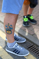 20th August 2017 - Premier League - Huddersfield Town v Newcastle United - A tattoo of an old Huddersfield club crest on a fan's leg - Photo: Simon Stacpoole / Offside.