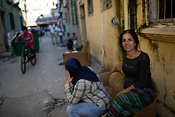 © Licensed to London News Pictures. 16/08/2020. Beirut, Lebanon. A woman poses for a photo in the Karantina district of Beirut which has been badly destroyed following the huge explosion in Beirut Port on 4 August. Photo credit : Tom Nicholson/LNP