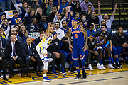 Golden State Warriors guard Stephen Curry (30) scores an off balance three pointer against the New York Knicks at Oracle Arena in Oakland, Calif., on May 2, 2017. (Stan Olszewski/Special to S.F. Examiner)