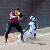 Rehoboth Lynx Jayme Daniels (11) catches a throw at third base as Tohatchi Cougar Krystal Benally (2) slides safe at Tohatchi High School Tuesday.