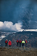 People observing the erupting volcano in Eyjafjallajökull, southern Iceland in May 2010