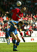 Photo: Scott Heavey<br />Charlton Athletic V Leeds Utd. 05/04/03<br />Mark Fish (top) of charlton gets to grips with Mark Viduka during this FA Barclaycard Premiership match.