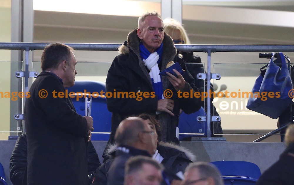 Norman Cook takes his seat before the start of  the Sky Bet Championship match between Brighton and Hove Albion and Wolverhampton Wanderers at the American Express Community Stadium in Brighton and Hove. October 18, 2016.<br /> James Boardman / Telephoto Images<br /> +44 7967 642437