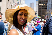 New York, NY - April 16, 2017. A young woman wears a straw hat at New York's annual Easter Bonnet Parade and Festival on Fifth Avenue.