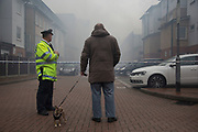 Local residents look on as fire crew tackle a fire in a block of flats in Brodlove Lane in Wapping, London, United Kingdom. According to sources the fire was possibly due to gas cylinders which were in a builders yard at the base of the building. A local resident said that there were often fires in this area, though he didn't know what was the cause. (photo by Mike Kemp/In Pictures via Getty Images)