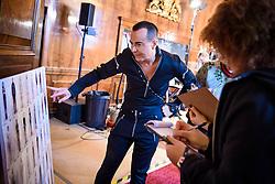 Designer Julien Macdonald makes last minute adjustments backstage before the Julien Macdonald Autumn/Winter 2017 London Fashion Week show at Goldsmith's Hall, London.