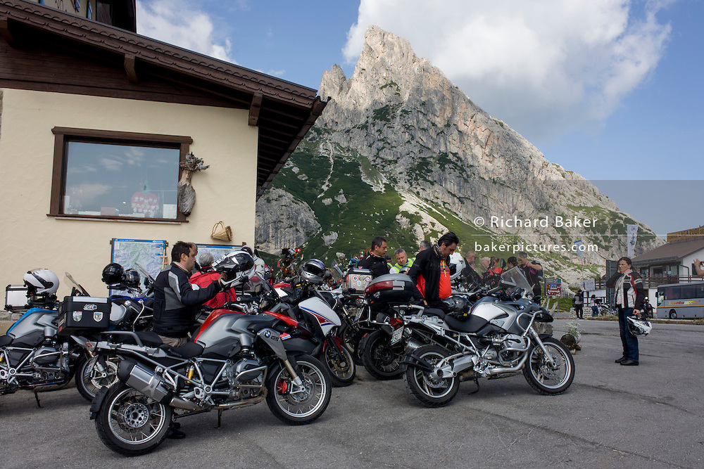 A group of bikers rest up on Passo Falzarega (Pass) in south Tyrol, Italy.
