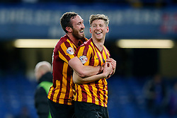 Rory McArdle and Jonathan Stead of Bradford City celebrate after Bradford City pull of a remarkable comeback from 2-0 down to win the match 2-4 and progress to the fifth round of the FA Cup - Photo mandatory by-line: Rogan Thomson/JMP - 07966 386802 - 24/01/2015 - SPORT - FOOTBALL - London, England - Stamford Bridge - Chelsea v Bradford City - FA Cup Fourth Round Proper.