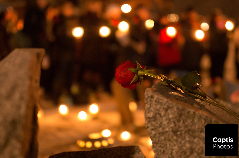 A rose sits on the Women's Monument in Minto Park during a vigil marking the 25th anniversary of the Ecole Polytechnique shooting in Montreal. December 6, 2014