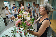 """Rachel running a Sunday morning flower arranging course at 'Green and Gorgeous'. Rachel demonstrates how to make a bouquet using British flowers<br /><br />Rachel is the owner of """"Green and Gorgeous"""" Flower Farm in Oxfordshire. She is well known for the flower arranging courses she offers. Her flower farm also caters for events, weddings and private picking<br /><br />British local flowers, grown nearby, count for around 10% of the UK market, traveling less than a tenth of their foreign counterparts which are often flown in from abroad. Nearly 90% of the flowers sold in the UK are actually imported, and many travel over 3000 miles. Local flower farms help biodiversity, providing food and habitat to a huge variety of wildlife, insects including butterflies, bugs, and bees. Often local flower farmers prefer to grow organic rather than using pesticides. British flowers bloom all the year around, even in the depths of winter, and there are local flower farms throughout the country.<br /><br />Many people like the idea of the just picked from the garden look, and come to flower farms throughout Britain to pick their own for weddings, parties and garden fetes. Others come for the joy of a day out in the countryside with their family. Often a bride and her family will come to pick the flowers for her own wedding, some even plant the seeds earlier in the year."""