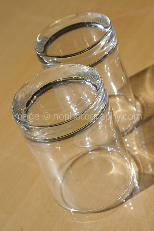 Two glasses on wooden surface