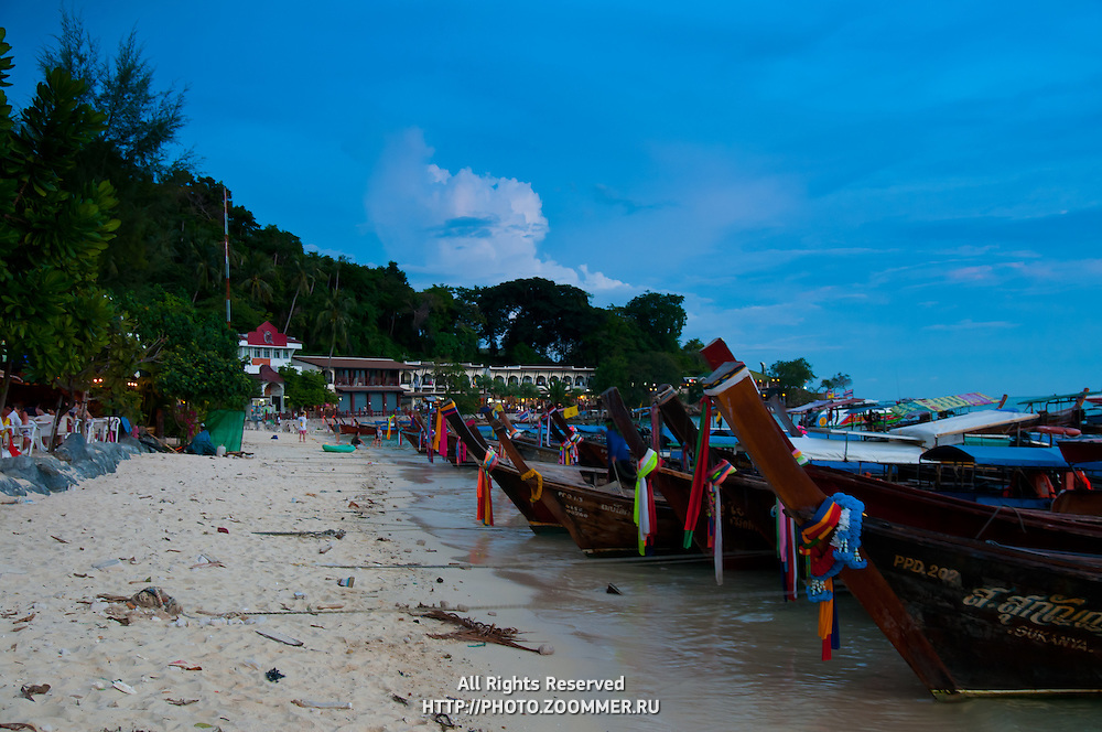 Longtail boats in the port of Phi-Phi island in the sunset, Thailand
