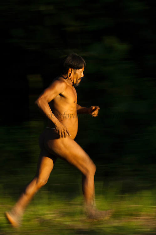 Huaorani Indian, Meñewa Wane running.<br /> Bameno Community. Yasuni National Park.<br /> Amazon rainforest, ECUADOR.  South America<br /> This Indian tribe were basically uncontacted until 1956 when missionaries from the Summer Institute of Linguistics made contact with them. However there are still some groups from the tribe that remain uncontacted.  They are known as the Tagaeri & Taromenane. Traditionally these Indians were very hostile and killed many people who tried to enter into their territory. Their territory is in the Yasuni National Park which is now also being exploited for oil.