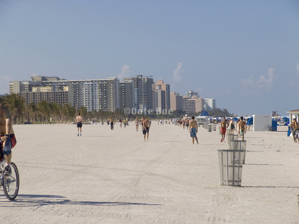 people strolling on the beach of Miami Beach