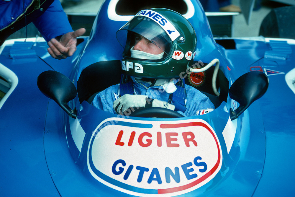 Jacques Laffite (Ligier-Matra) in the pits with his helmet on during practice for the 1976 Spanish Grand Prix in Jarama. Photo: Grand Prix Photo