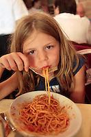 August 2005, Venice, Italy --- Girl Eating Spaghetti --- Image by © Owen Franken/Corbis