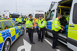 © Licensed to London News Pictures. 13/09/2021. Staines, UK. Police officers remove the last protester as climate campaign group 'Insulate Britain', an offshoot of Extinction Rebellion (XR), block the clockwise slip road at Poyle Interchange/junction 14, M25 London Orbital Motorway. Photo credit: Peter Manning/LNP