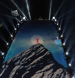 07-02-2011 SKIEN: FIS ALPINE WORLD CHAMPIONSSHIP: GARMISCH PARTENKIRCHEN<br /> An image of the Zugspitze mountain is projected onto the landing area for the ski jump as a climber climbs to the top during the opening ceremony for the 2011 Alpine skiing World Championships<br /> **NETHERLANDS ONLY**<br /> ©2011-WWW.FOTOHOOGENDOORN.NL/NPH-Mitchell Gunn
