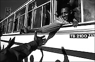 Conscripts are cheered off from the capital, Asmara, as they leave to begin their mandatory 2-year National Service. .Eritrea emerged from a 30-year struggle for Independence only to slip back in to a bloody border war with its old adversary, Ethiopia. An estimated 100,000 soldiers from both sides died in the conflict.