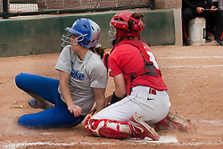 15 April 2012:  Catcher Caiti Kopp covers the plate and tags a Bulldog out at home during an NCAA women's softball game between the Drake Bulldogs and the Illinois State Redbirds on Marian Kneer Field in Normal IL