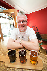 Simon Rutherford, at Rutherfords Micropub in Kelso. Pic of the beer taster.